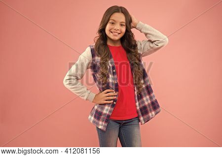 Happy Childrens Day. Little Girl Pink Background Copy Space. Teen Promoting Fashion Clothes. Kids Fa
