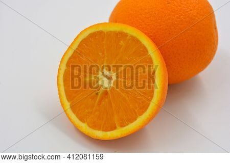 Healthy Ripe Delicious Fruits For Human Health. Juicy Fruits Of An Orange Orange. One Whole Orange A