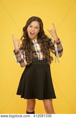 Crazy Cool. Cool Child Show Horns Sign. Little Girl With Cool Look Yellow Background. School Fashion