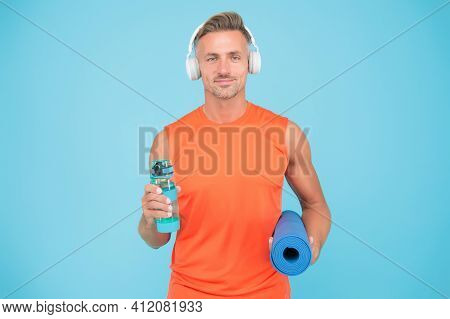 Music For Workout. Challenge Multiple Muscle Groups. Man Practicing Yoga At Home. Mature Sportsman W