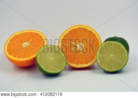 Healthy Ripe Delicious Fruits For Human Health. Juicy Fruits Of Orange Orange, Lime With Bright Gree