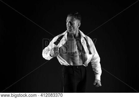 Be Inspiration. Bodybuilder Or Muscleman Black Background. Elegant Bodybuilder Show Six Pack Abs In