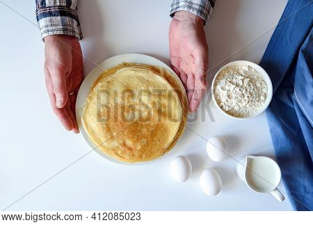 A Lot Of Pancakes Are Stacked On A White Plate. Thin Pancakes With A Crispy Crust. Pancake Day. Panc