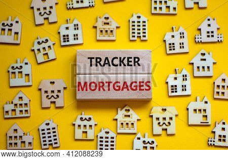 Tracker Mortgage Symbol. Concept Words 'tracker Mortgage' On Wooden Blocks On A Beautiful Yellow Bac