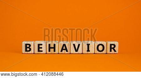 Behavior Symbol. Wooden Cubes With Word 'behavior'. Beautiful Orange Background. Business, Psycholog