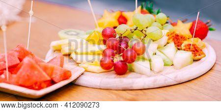 Fresh Fruit Platter. Raw Organic Fruit Platter With Berries, Melons, Kiwi, Mango, Pineapple, Waterme