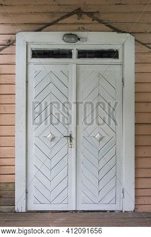 White Weathered Wooden Door In An Old Obsolete House
