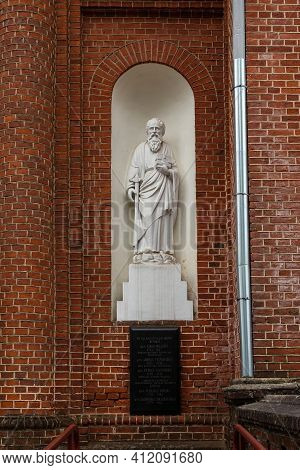 Statue Of The Saint Paul On The External Wall Of The Church Of The Ascension Of Christ In Utena, Lit
