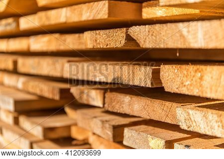 Wooden Planks And Beams. Air-drying Timber Stack. Wood Air Drying. Wood For House Construction. Buil