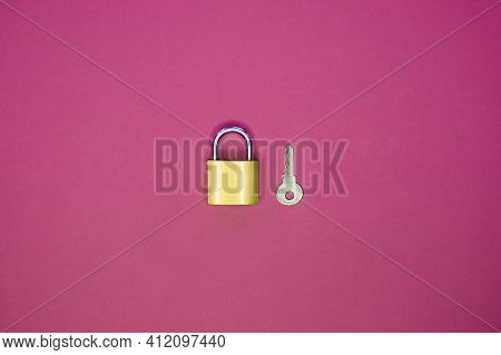 Lock And Key On A Purple Background