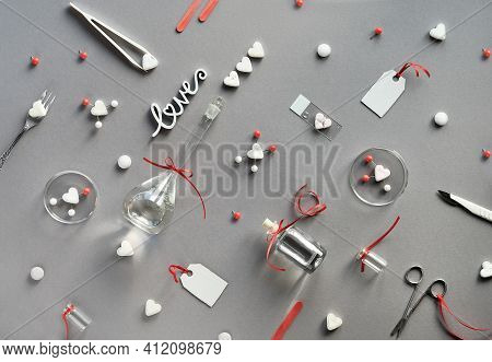 Chemistry Of Love. Creative Flat Lay On Grey Paper. Top View With Chemical Glassware, Petri Dishes,