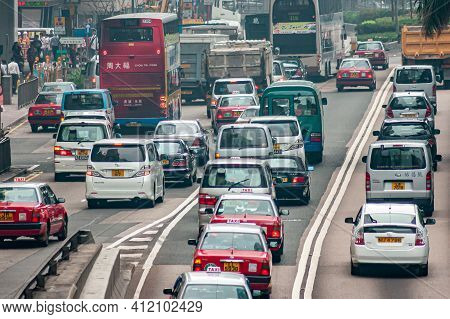 Hong Kong Island, China - May 14, 2010: Traffic On North Side With Multilane Lines Of Cars, Trucks,