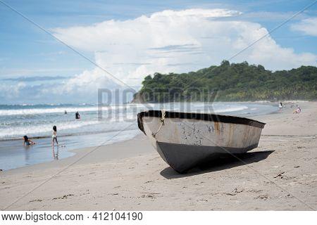 A Boat In The Sand On Beach, Playa Samara, Costa Rica