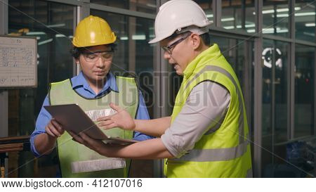 Two Factory Industrial Workers Technician Or Engineer And Manager Wear Uniforms Safety Feeling Upset