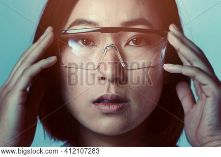 Businesswoman wearing AR smart glasses futuristic technology