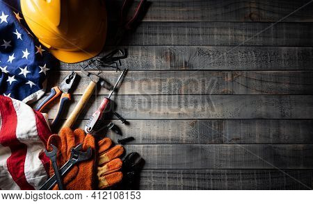 Happy Labor Day Concept. American Flag With Different Construction Tools On Dark Wooden Background,