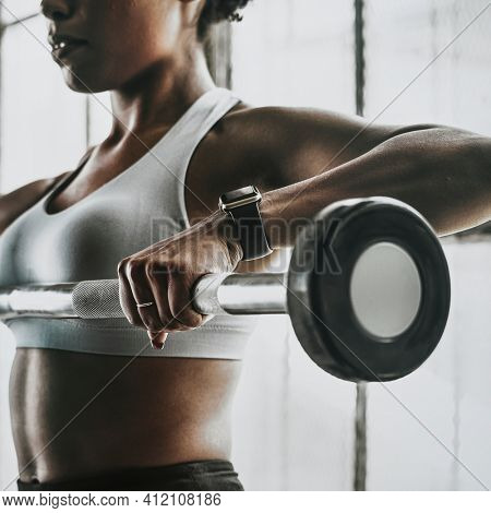 Woman weightlifting with a barbell