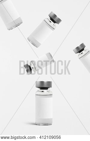 Falling injection vial glass bottles with white labels