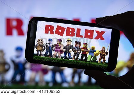 London, Uk - March 2021: Person Holding A Smartphone With Roblox Game Logo