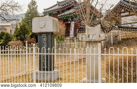 Daejeon, South Korea; March 9, 2021: Commemorative Steles Behind White Fence At Confucian School In