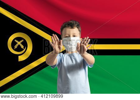 Little White Boy In A Protective Mask On The Background Of The Flag Of Vanuatu. Makes A Stop Sign Wi