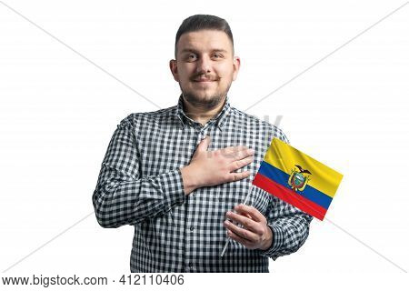 White Guy Holding A Flag Of Ecuador And Holds His Hand On His Heart Isolated On A White Background W