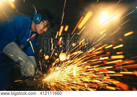 Electric Wheel Grinding On Steel Structure In Factory, This Image Can Use For Industrial, Worker And