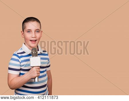 Funny Child Performs. Boy Sings A Song Into The Microphone. Talented Child Sings Karaoke. Boy Singin