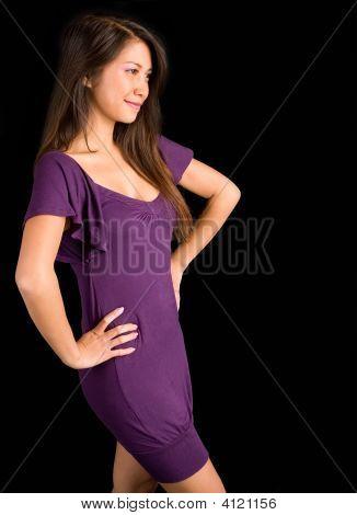 Beautiful Brunette Lady Posing In A Purple Dress