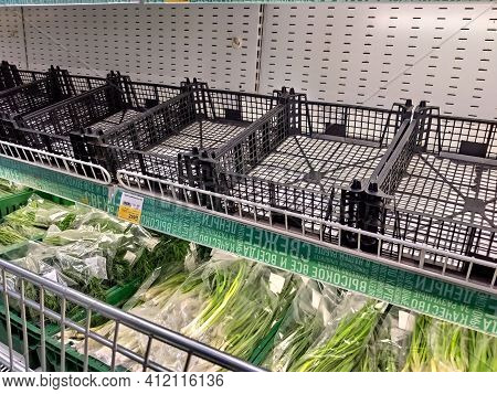 Empty Shelves In The Supermarket. The Stores Shelves Were Emptied Due To The Panic Purchases Of Cust