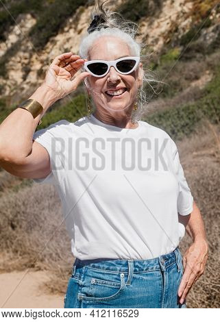 Mature woman in white tee  for summer outdoor shoot