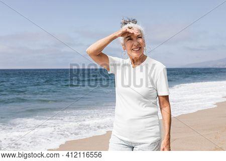 Senior woman enjoying at the summer beach