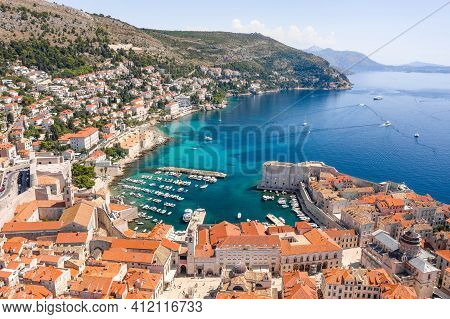 Aerial Drone Shot Of Old Port In Dubrovnik Old Town In Croatia Summer Morning