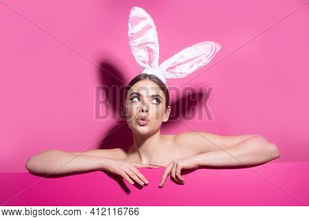Easter Funny Woman With Rabbit Ears. Portrait Of A Pretty Lovely Girl Isolated On Pink Banner, Copy