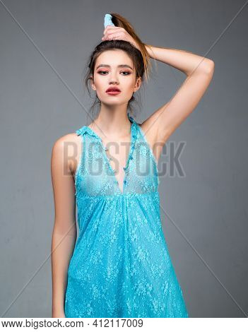 Beautiful Young Elegant Girl In Sexy Blue Dress. Portrait On Gray Background. Fashionable Attire, Ga