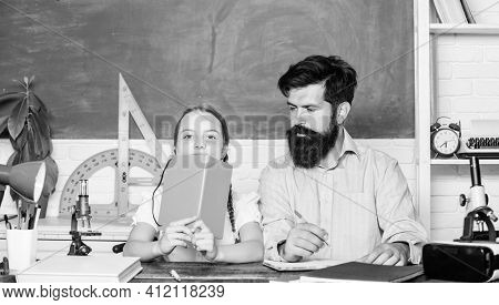 Explaining Science To Child. School Teacher And Schoolgirl. Man Bearded Teacher Excellent Pedagogue.