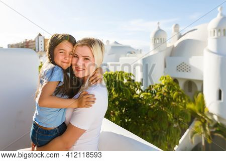 Portrait Happy Loving Family, Mother And Daughter Playing And Hugging. Mother And Daughter Laugh Sin