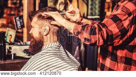 Hairdresser Cutting Hair Of Male Client. Man Visiting Hairstylist In Barbershop. Barber Scissors. Be