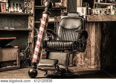 Stylish Vintage Barber Chair. Professional Hairstylist In Barbershop Interior. Barber Shop Chair. Ba