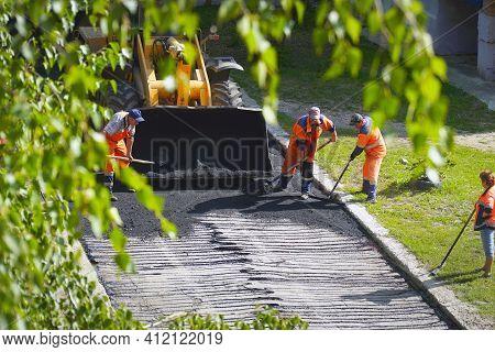 Chapaevsk, Samara Region, Russia - August 25, 2020: Road Street Repairing Works. Construction Worker