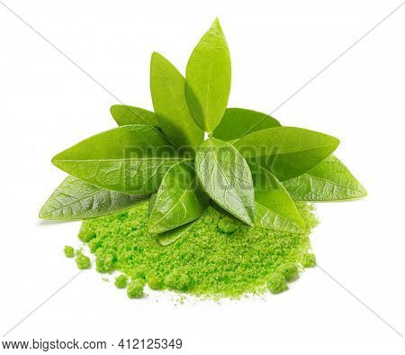Green tea leaves and matcha powder isolated on white background.
