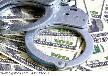 The Handcuffs Are On Hundred-dollar Bills. Power And Bribery. Criminal Ransom. Criminal Earnings. Bu
