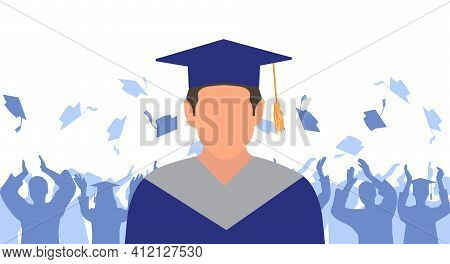 Man Graduate In Mantle And Academic Square Cap On Background Of Cheerful Crowd Of Graduates Throwing