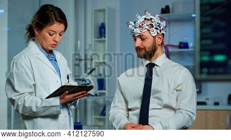 Expert Research Doctor In Neuroscience Developing Treatment For Neurological Diseases Discussing Pat