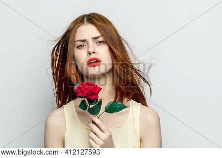 Emotional Woman With Rose Flower Displeasure Cry