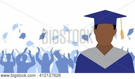 African American Man Graduate In Mantle And Academic Square Cap On Background Of Cheerful Crowd Of G