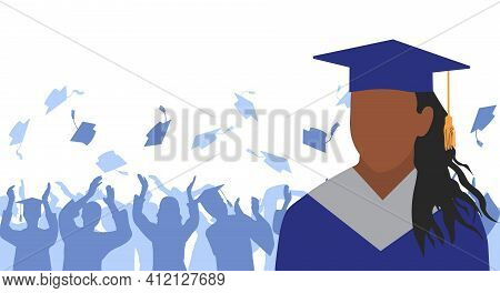 African American Girl Graduate In Mantle And Academic Square Cap On Background Of Cheerful Crowd Of