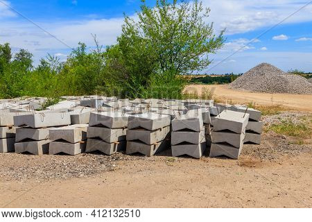 Stacks Of The New Concrete Road Curbs For Road Construction