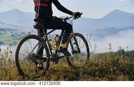 Young Man Riding A Mountain Bike Downhill Style