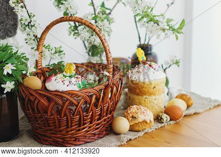 Stylish Easter Eggs, Homemade Easter Bread, Delicious Traditional Easter Food In Wicker Basket And B